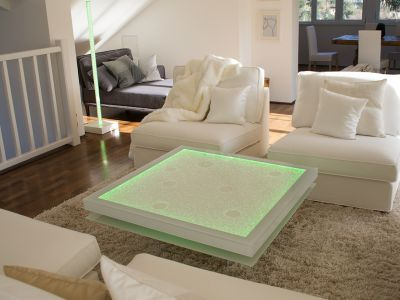 Glaszone Glass Table Shine with white enamel frame and green RGB-lighting