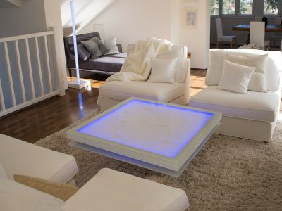 Glaszone Glass Table Shine with white enamel frame and blue RGB-lighting