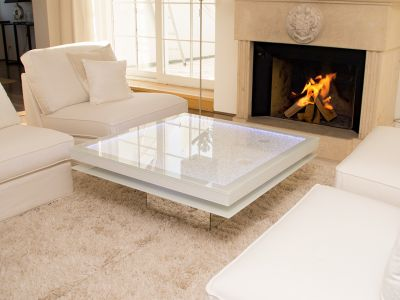 Glaszone Glass Table Shine with white enamel frame next to the fireplace